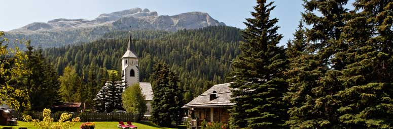 Corvara, in Alta Badia, among green forest