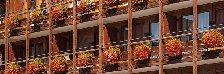 Typical balconies with flowers from S. Cristina