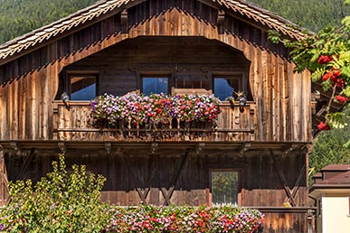 Flowers on a wooden house in San Candido