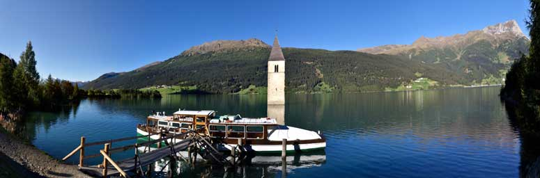 The fascinating Resia lake with the bell tower of Curon