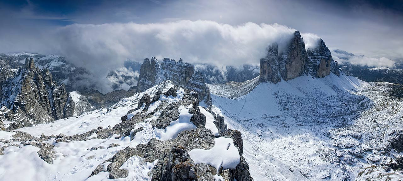 Aerial view of the snowy Tre Cime di Lavaredo of the Alta Pusteria part of the Dolomites