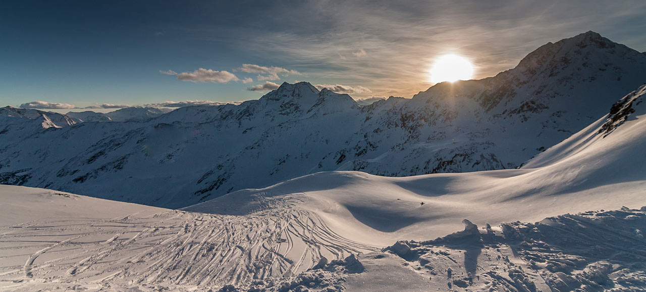 An impressive winter landscape with the rising sun in the mountains of South Tyrol