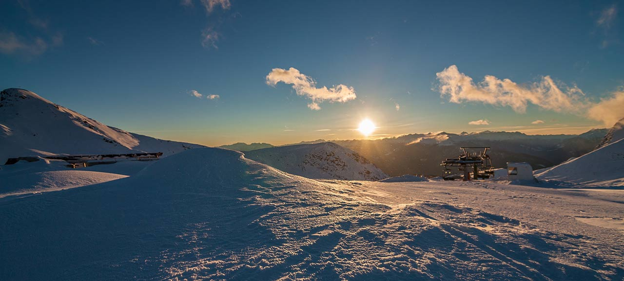 Winter panorama in the setting sun on a ski slope near Merano