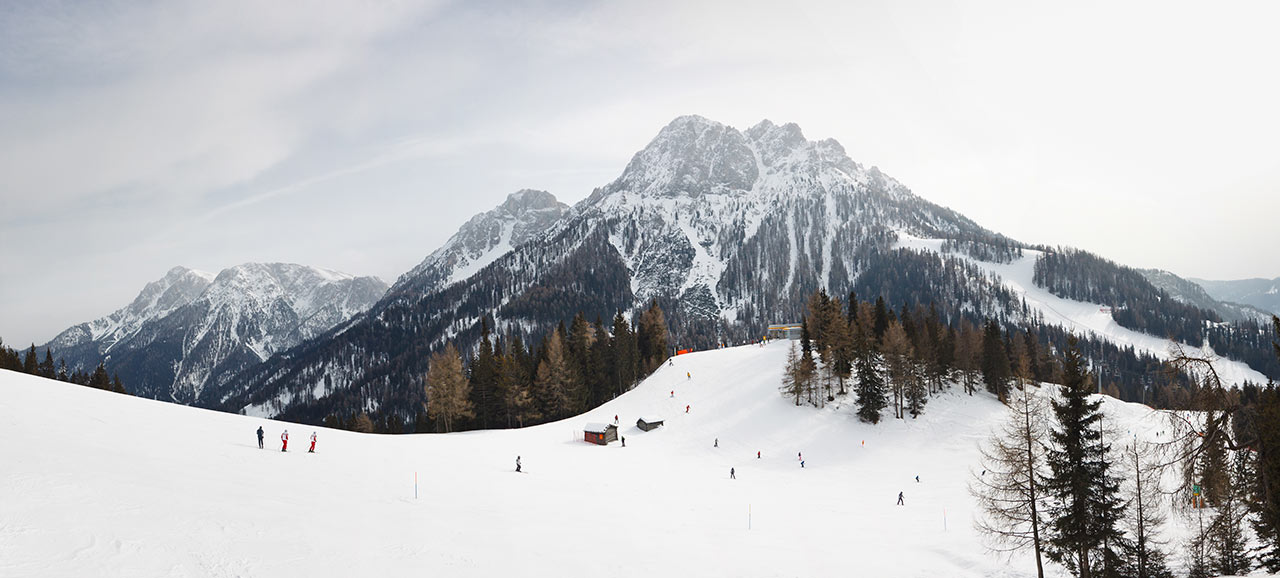 The Kronplatz in winter with views of snow-covered mountains
