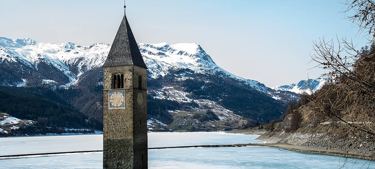 The frozen lake of Resia with the church steeple sticking out of the water