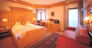 Free bedrooms at the Hotel Genziana - Enzian at Siusi / Seis am Schlern