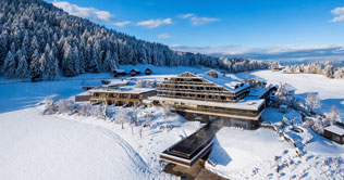 Winter panoramic view of the Hotel Pfösl in Nova Ponente